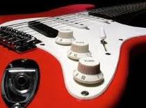 Jak akompaniować na gitarze za pomocą grania pasażem
