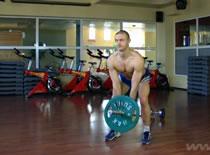 Jak wykonywać ćwiczenia pleców - wiosłowanie końcem sztangi