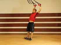 Jak ćwiczyć różne partie mięśni - pełen wyprost na TRX