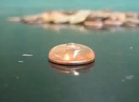 Jak przeprowadzić pokaz z wodą i monetą